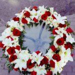 coroana-funerara-rotunda-cu-flori-galbene-3002_3002_1_1539783899.jpg